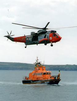On exercise with Sea King helicopter.